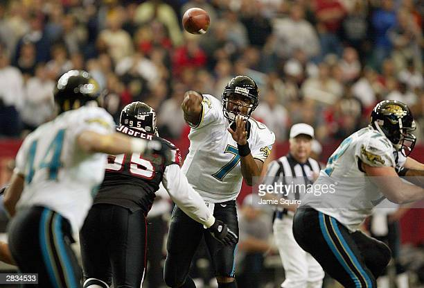 Quarterback Byron Leftwich of the Jacksonville Jaguars passes to Marc Edwards against the Atlanta Falcons on December 27, 2003 at the Georgia Dome in...