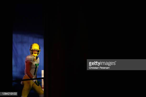 Quarterback Cale Millen of the Oregon Ducks walks out to the field during the second half of the PlayStation Fiesta Bowl against the Iowa State...