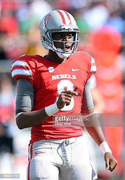 Quarterback Caleb Herring of the UNLV Rebels gets signals from the sideline during a game against the San Jose State Spartans at Sam Boyd Stadium on...