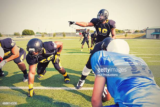 quarterback calling an audible play during semi-professional football game - quarterback stock pictures, royalty-free photos & images