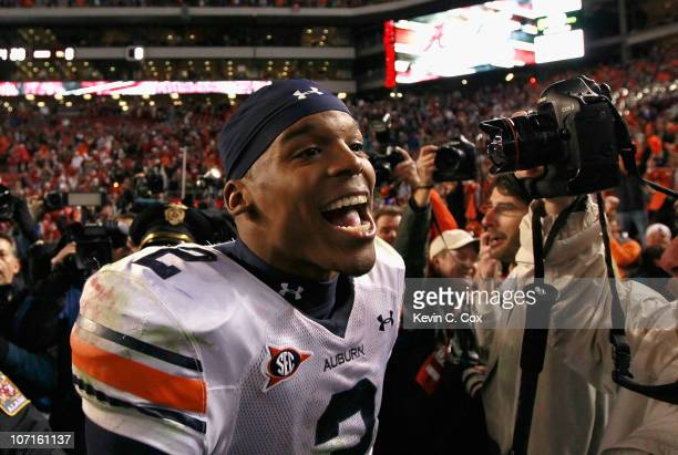 Quarterback Cam Newton of the Auburn Tigers celebrates their 2827 win over the Alabama Crimson Tide at BryantDenny Stadium on November 26 2010 in...