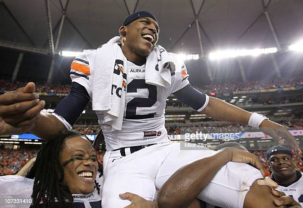 Quarterback Cam Newton of the Auburn Tigers is carried on the field after the 2010 SEC Championship against the South Carolina Gamecocks at Georgia...