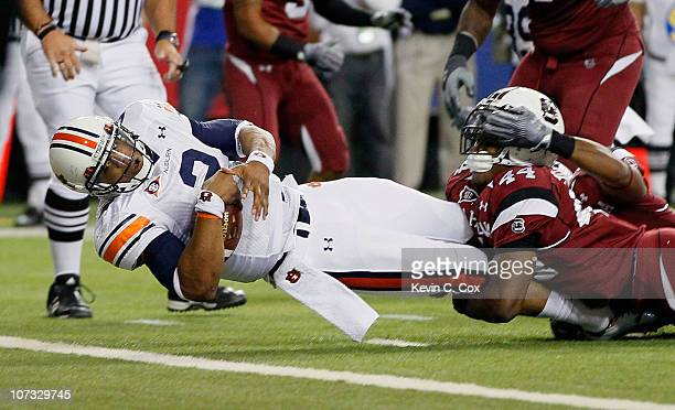 Quarterback Cam Newton of the Auburn Tigers scores a touchdown against Tony Straughter of the South Carolina Gamecocks during the 2010 SEC...