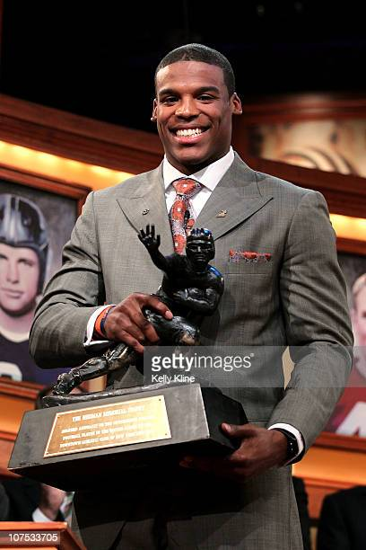 Quarterback Cam Newton of the Auburn University Tigers poses with the trophy after being named the 76th Heisman Memorial Trophy Award winner at the...