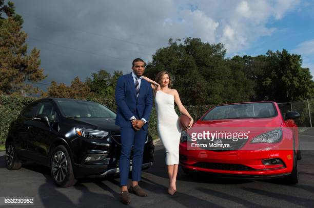 Quarterback Cam Newton of the Carolina Panthers and model Miranda Kerr pose for a photo at 'Buick Super Bowl ad featuring the cascada and encore with...