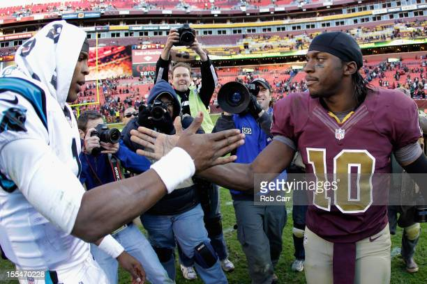 Quarterback Cam Newton of the Carolina Panthers and quarterback Robert Griffin III of the Washington Redskins shake hands following the Panthers 2113...