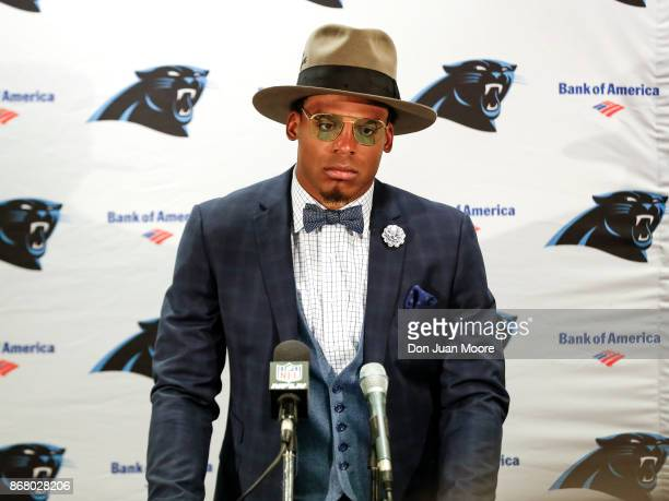 Quarterback Cam Newton of the Carolina Panthers answers questions from the media at a press conference after the game against the Tampa Bay...