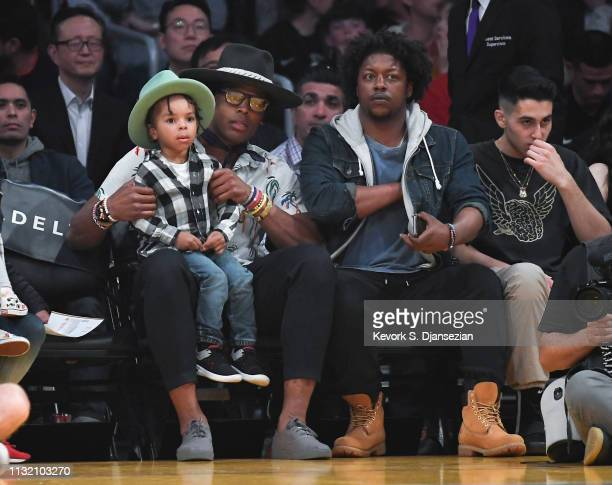Quarterback Cam Newton of the Carolina Panthers attends a basketball game between the Los Angeles Lakers and Brooklyn Nets at Staples Center on March...