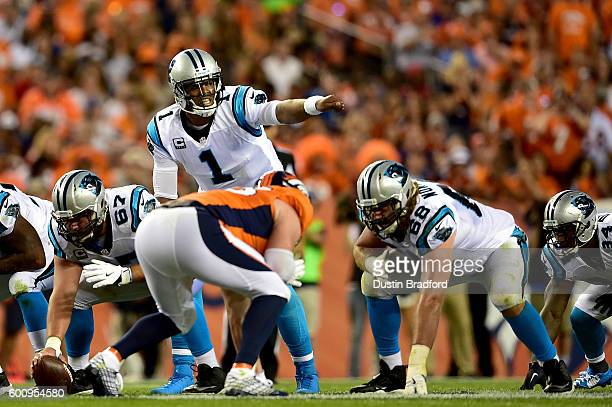 Quarterback Cam Newton of the Carolina Panthers calls out from under center in the first half against the Denver Broncos at Sports Authority Field at...