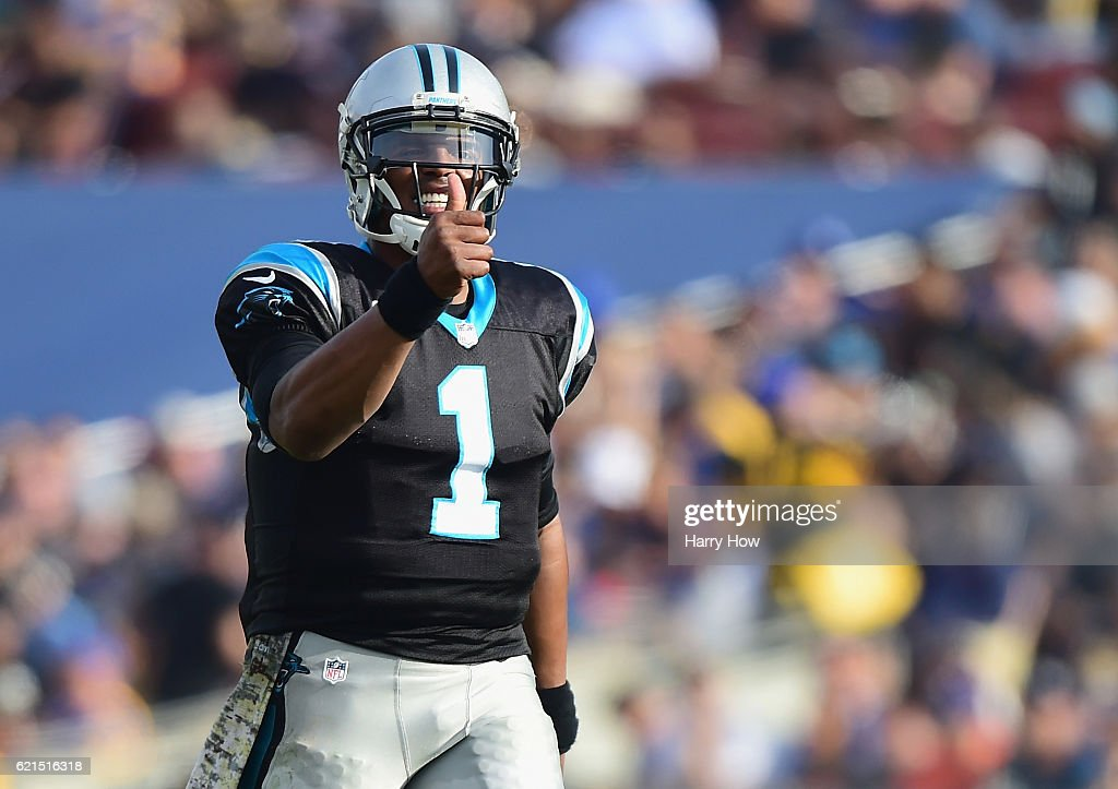 Quarterback Cam Newton #1 of the Carolina Panthers celebrates a pass to teammate Kelvin Benjamin #13 (not pictured) for a first down during the second quater of the game against the Los Angeles Rams at the Los Angeles Coliseum on November 6, 2016 in Los Angeles, California.