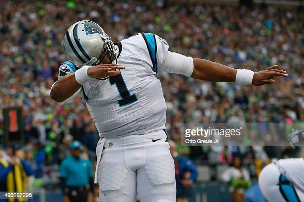 Quarterback Cam Newton of the Carolina Panthers celebrates after scoring a touchdown against the Seattle Seahawks at CenturyLink Field on October 18...