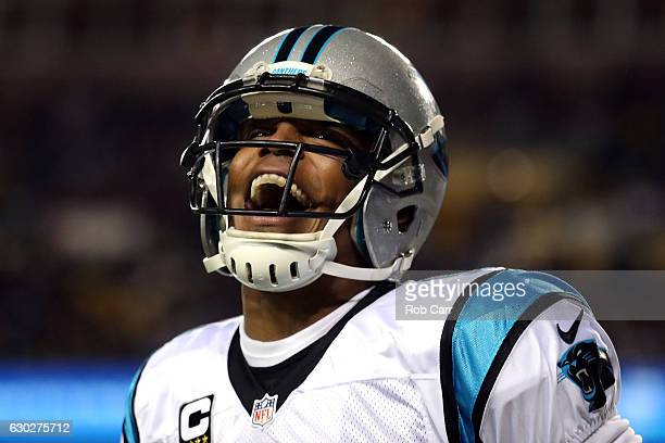 Quarterback Cam Newton of the Carolina Panthers celebrates after throwing a first quarter touchdown to teammate wide receiver Ted Ginn against the...
