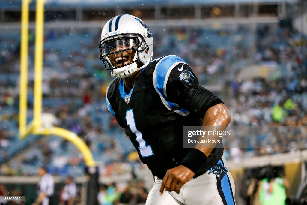 Quarterback Cam Newton #1 of the Carolina Panthers celebrates after throwing a touchdown pass during the game against the Jacksonville Jaguars at EverBank Field on August 24, 2017 in Jacksonville, Florida. The Panthers defeated the Jaguars 24 to 23.