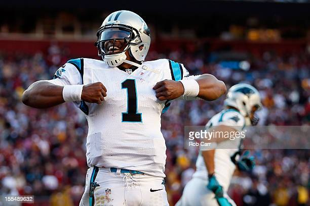 Quarterback Cam Newton of the Carolina Panthers celebrates after rushing for a fourth quarter touchdown against the Washington Redskins at FedExField...