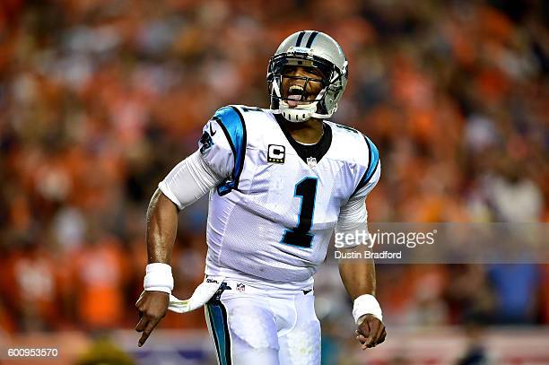 Quarterback Cam Newton of the Carolina Panthers celebrates after scoring on a twoyard rushing touchdown in the second quarter against the Denver...