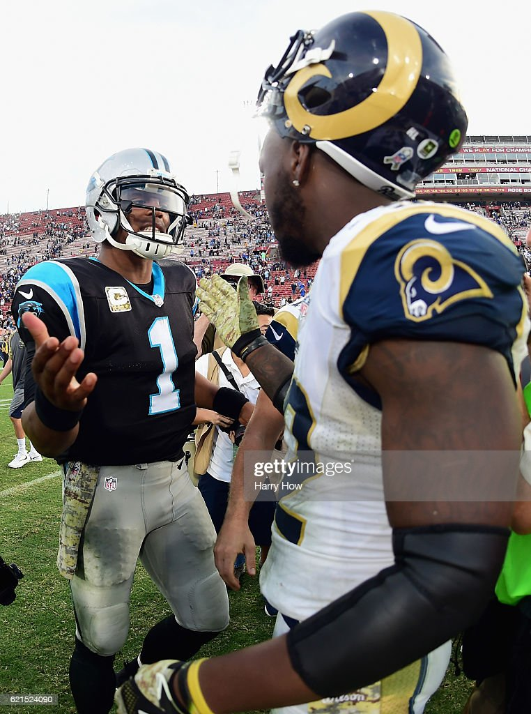 Quarterback Cam Newton #1 of the Carolina Panthers greets Alec Ogletree #52 of the Los Angeles Rams after the Panthers won the game 13-10 at the Los Angeles Coliseum on November 6, 2016 in Los Angeles, California.