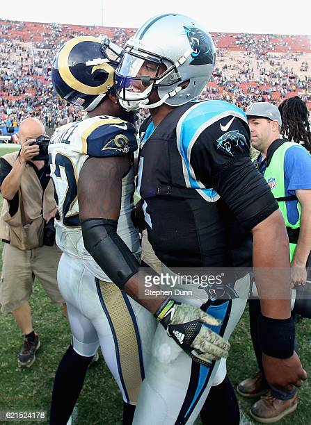 Quarterback Cam Newton of the Carolina Panthers greets Alec Ogletree of the Los Angeles Rams after the Panthers won the game 1310 at the Los Angeles...
