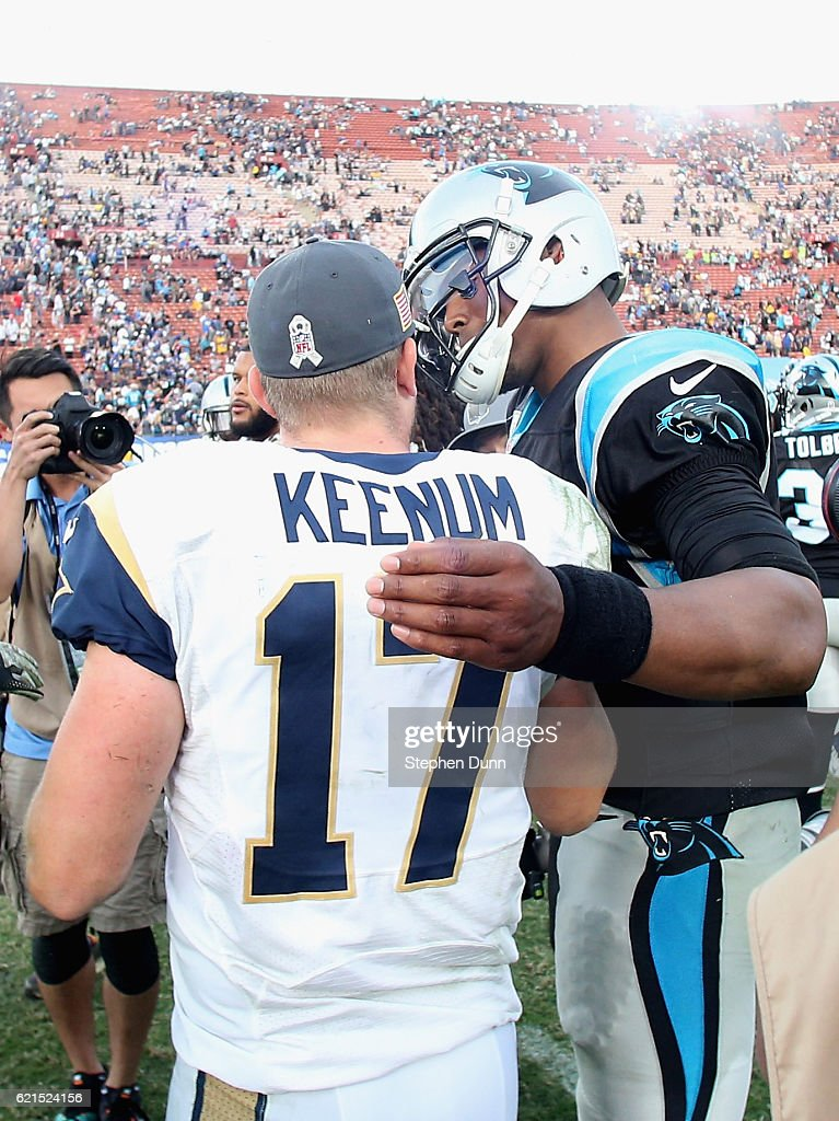 Quarterback Cam Newton #1 of the Carolina Panthers greets quarterback Case Keenum #17 of the Los Angeles Rams after the Panthers won the game 13-10 at the Los Angeles Coliseum on November 6, 2016 in Los Angeles, California.
