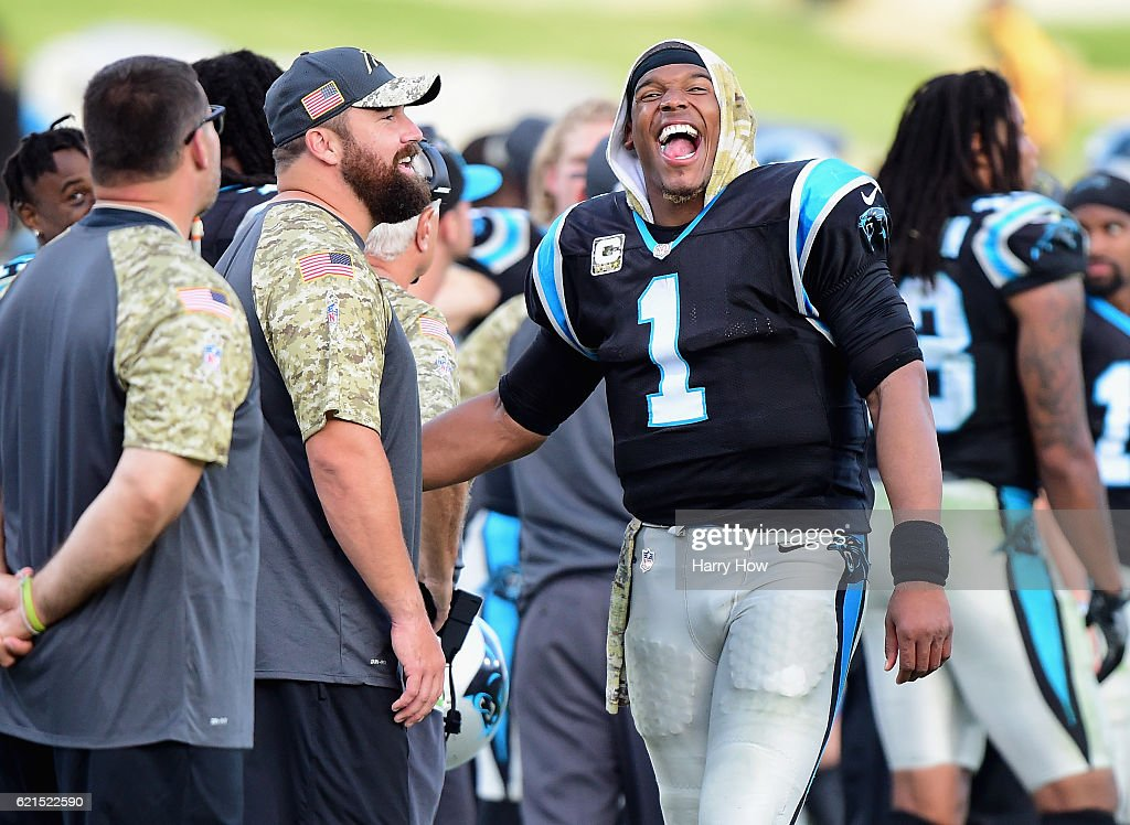Quarterback Cam Newton #1 of the Carolina Panthers has a laugh on the sidelines in the last minute of the fourth quarter of the game against the Los Angeles Rams at the Los Angeles Coliseum on November 6, 2016 in Los Angeles, California.