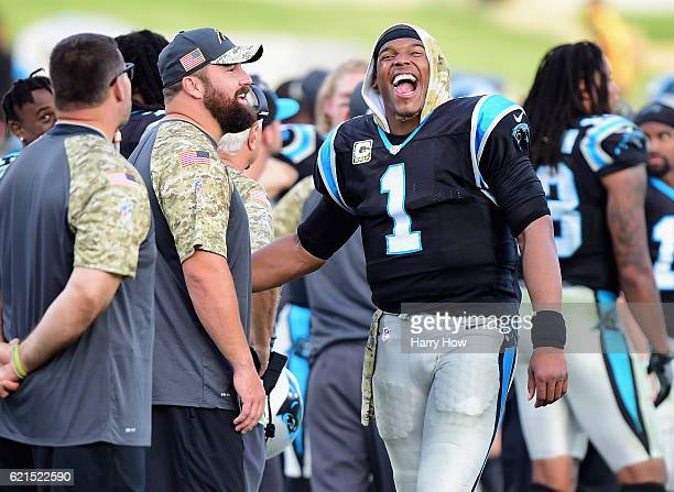 Quarterback Cam Newton of the Carolina Panthers has a laugh on the sidelines in the last minute of the fourth quarter of the game against the Los...