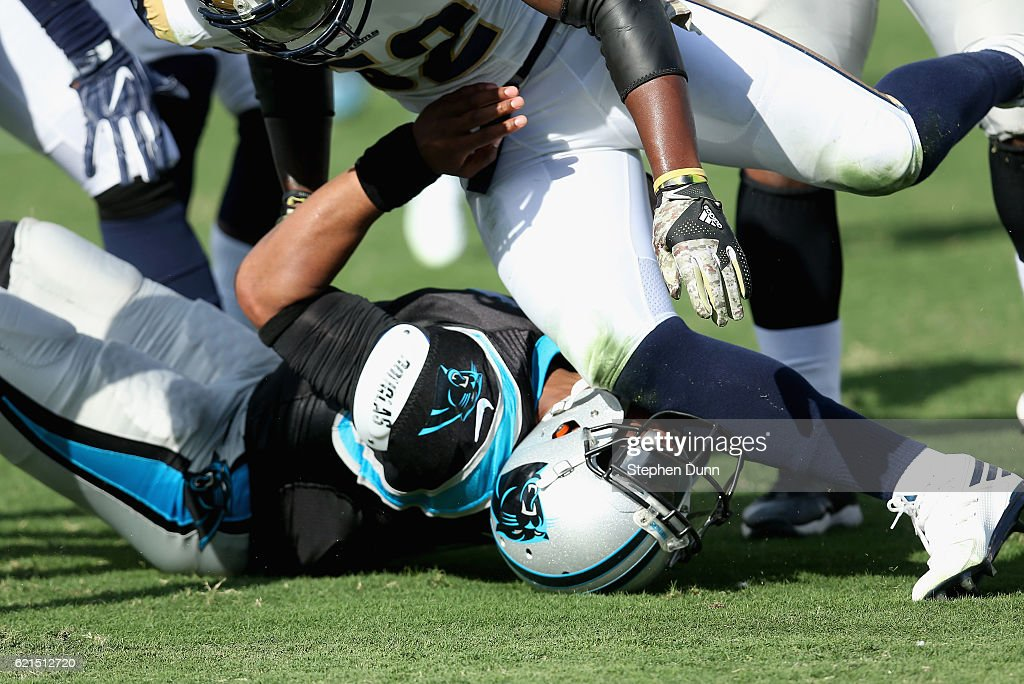 Quarterback Cam Newton #1 of the Carolina Panthers is hit by Alec Ogletree #52 of the Los Angeles Rams during the first quarter of the game at the Los Angeles Coliseum on November 6, 2016 in Los Angeles, California.