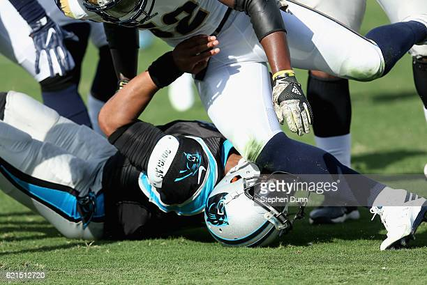 Quarterback Cam Newton of the Carolina Panthers is hit by Alec Ogletree of the Los Angeles Rams during the first quarter of the game at the Los...