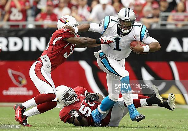 Quarterback Cam Newton of the Carolina Panthers is sacked by cornerback Richard Marshall of the Arizona Cardinals during the first quarter of the NFL...