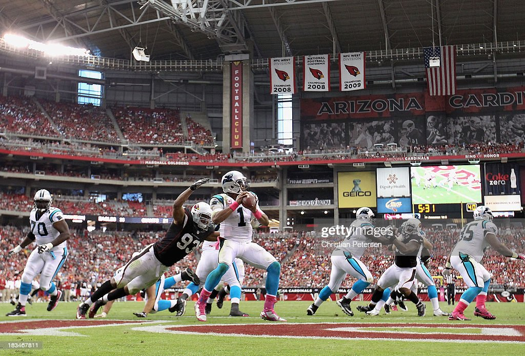 Quarterback Cam Newton #1 of the Carolina Panthers is sacked for a safety by defensive end Calais Campbell #93 of the Arizona Cardinals during the third quarter of the NFL game at the University of Phoenix Stadium on October 6, 2013 in Glendale, Arizona. The Cardinals defeated the Panthers 22-6.