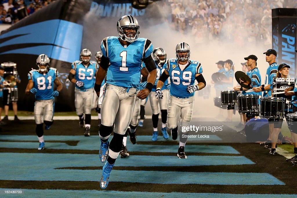 Quarterback Cam Newton #1 of the Carolina Panthers leads his teammates onto the field to play against the New York Giants at Bank of America Stadium on September 20, 2012 in Charlotte, North Carolina.