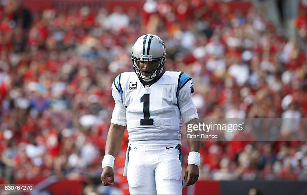 Quarterback Cam Newton of the Carolina Panthers makes his way to the sidelines during the first quarter of an NFL game against the Tampa Bay...