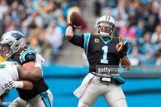 Quarterback Cam Newton of the Carolina Panthers passes against the Green Bay Packers during a NFL game at Bank of America Stadium on December 17 2017...