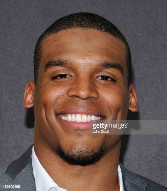 Quarterback Cam Newton of the Carolina Panthers poses in the press room during Cartoon Network's fourth annual Hall of Game Awards at Barker Hangar...