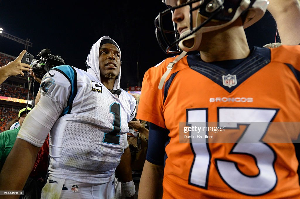 Quarterback Cam Newton #1 of the Carolina Panthers reacts after shaking hands on the field with quarterback Trevor Siemian #13 of the Denver Broncos after a 21-20 Denver Broncos win at Sports Authority Field at Mile High on September 8, 2016 in Denver, Colorado.