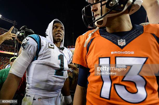 Quarterback Cam Newton of the Carolina Panthers reacts after shaking hands on the field with quarterback Trevor Siemian of the Denver Broncos after a...