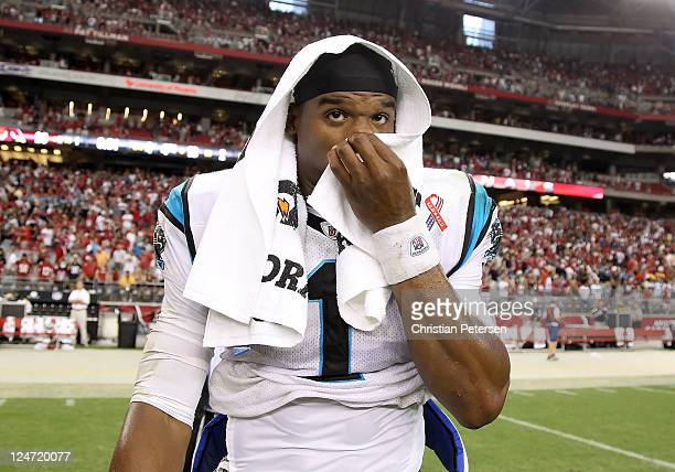Quarterback Cam Newton of the Carolina Panthers reacts as he walks off the field following the NFL season opening game against the Arizona Cardinals...