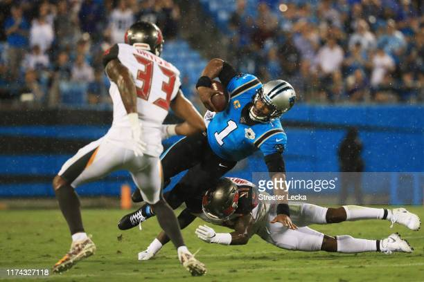 Quarterback Cam Newton of the Carolina Panthers scrambles against the Tampa Bay Buccaneers in the first quarter of the game at Bank of America...