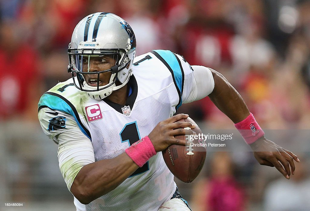 Quarterback Cam Newton #1 of the Carolina Panthers scrambles with the football during the NFL game against the Arizona Cardinals at the University of Phoenix Stadium on October 6, 2013 in Glendale, Arizona. The Cardinals defeated the Panthers 22-6.