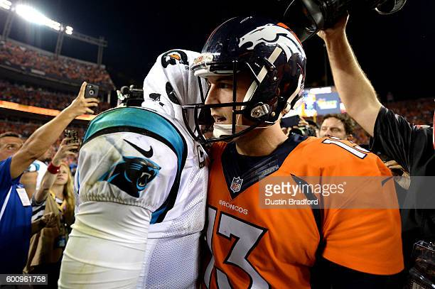 Quarterback Cam Newton of the Carolina Panthers shakes hands with quarterback Trevor Siemian of the Denver Broncos after the Panthers lose to the...