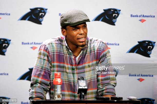 Quarterback Cam Newton of the Carolina Panthers talk with the media at the post game press conference after the game against the Jacksonville Jaguars...