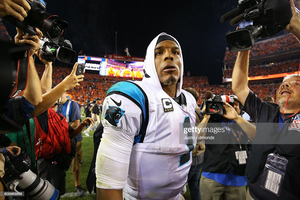 Quarterback Cam Newton #1 of the Carolina Panthers walks off the field after losing to the Broncos 21-20 at Sports Authority Field at Mile High on September 8, 2016 in Denver, Colorado.