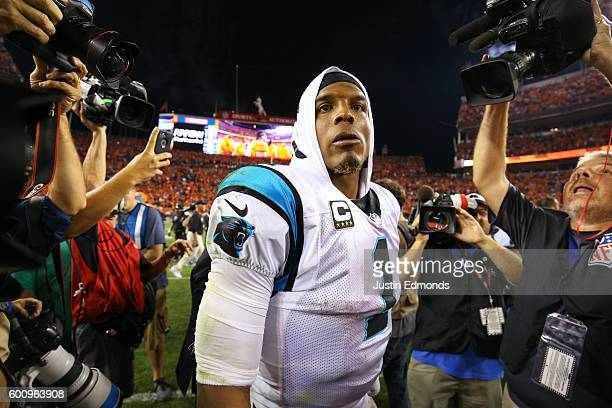 Quarterback Cam Newton of the Carolina Panthers walks off the field after losing to the Broncos 2120 at Sports Authority Field at Mile High on...