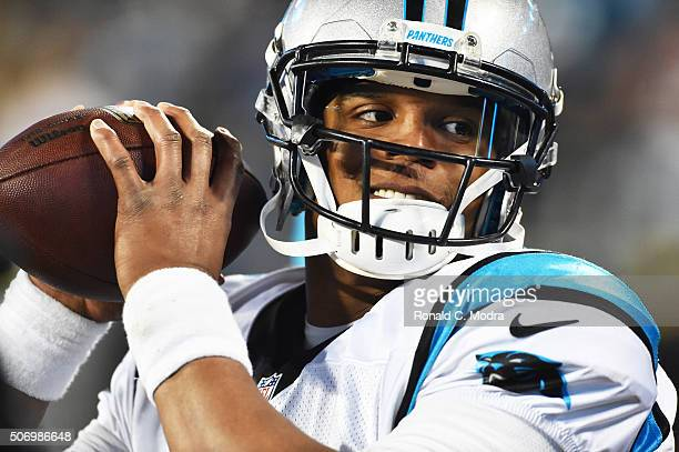 Quarterback Cam Newton of the Carolina Panthers warms up before the NFC Championship Game against the Arizona Cardinals at Bank of America Stadium on...