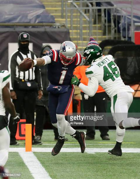 Quarterback Cam Newton of the New England Patriots has a Touchdown reception on a trick play against the New York Jets at Gillette Stadium on January...