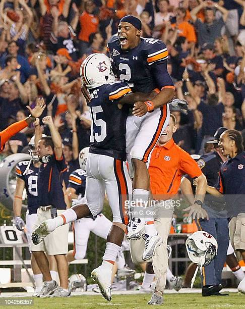 Quarterback Cameron Newton and Neiko Thorpe of the Auburn Tigers celebrate after their 2724 overtime win over the Clemson Tigers at JordanHare...