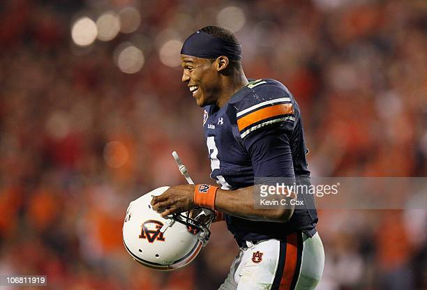 Quarterback Cameron Newton of the Auburn Tigers celebrates after an official review showed Newton crossed the end zone after diving for a touchdown...