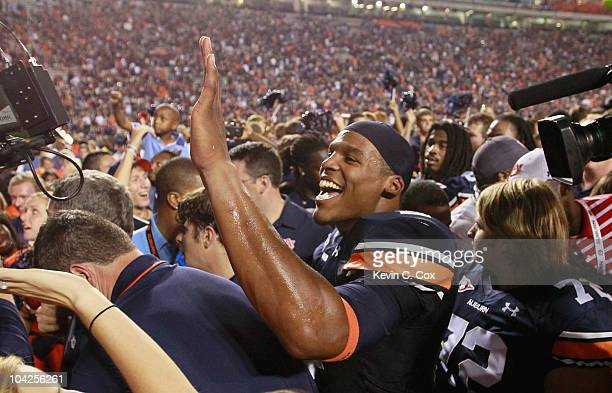 Quarterback Cameron Newton of the Auburn Tigers celebrates after their 2724 overtime win over the Clemson Tigers at JordanHare Stadium on September...