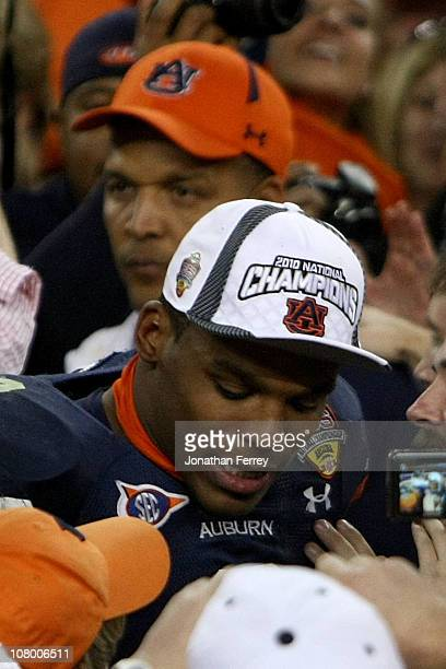 Quarterback Cameron Newton of the Auburn Tigers celebrates as his father Cecil Newton is behind him after the Tigers 2219 victory against the Oregon...