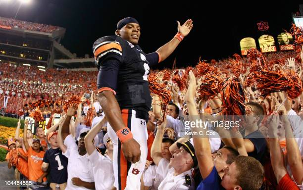 Quarterback Cameron Newton of the Auburn Tigers celebrates in the stands after their 3527 win over the South Carolina Gamecocks at JordanHare Stadium...