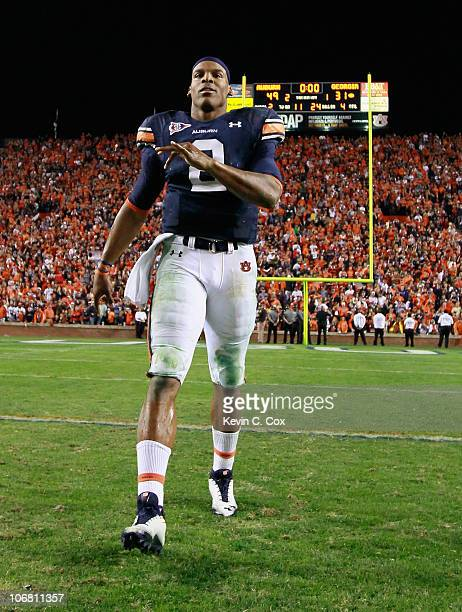 Quarterback Cameron Newton of the Auburn Tigers celebrates their 4931 win over the Georgia Bulldogs at JordanHare Stadium on November 13 2010 in...
