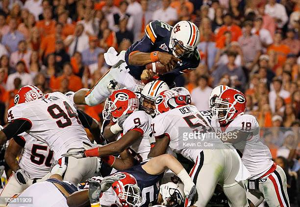 Quarterback Cameron Newton of the Auburn Tigers dives across the defense for a touchdown against the Georgia Bulldogs at JordanHare Stadium on...